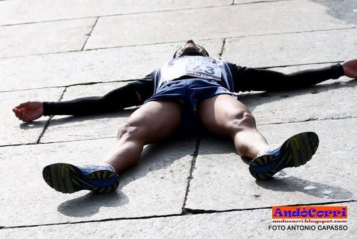Tired Runner Lying on the Ground